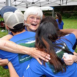 Liz Putnam & SCA members hug