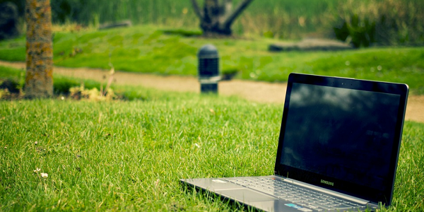 Computer in green space image